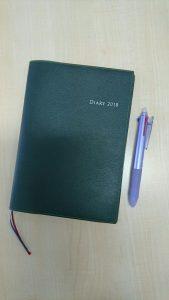 緑の手帳とペン